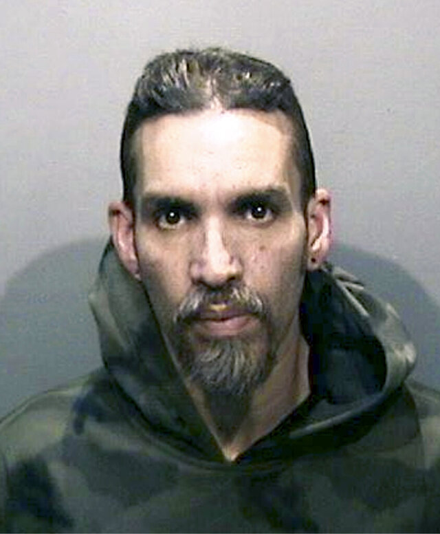 FILE - This Monday, June 5, 2017, file photo released by the Alameda County Sheriff's Office shows Derick Almena at Santa Rita Jail in Alameda County, Calif. Almena who is man charged with manslaughter in the Ghost Ship blaze that killed 36 partygoers at a firetrap warehouse in Northern California may be released from jail because of the coronavirus outbreak, a judge ruled. An Alameda County Superior Court Judge has decided to release Almena from custody at Santa Rita Jail in Dublin and place him in an electronic monitoring program while he awaits retrial, officials said Wednesday, April 8, 2020. (Alameda County Sheriff's Office via AP, File)