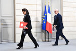 French Health and Solidarity Minister Agnes Buzyn, left, and French High Commissioner for Pension Reform Laurent Pietraszewski leave after a press conference at the Elysee Palace after a weekly cabinet meeting and an official presentation of the pension overhaul reform, Friday, Jan.24, 2020 in Paris. French unions are holding last-ditch strikes and protests around the country Friday as the government unveils a divisive bill redesigning the national retirement system. ( Alain Jocard/Pool via AP)