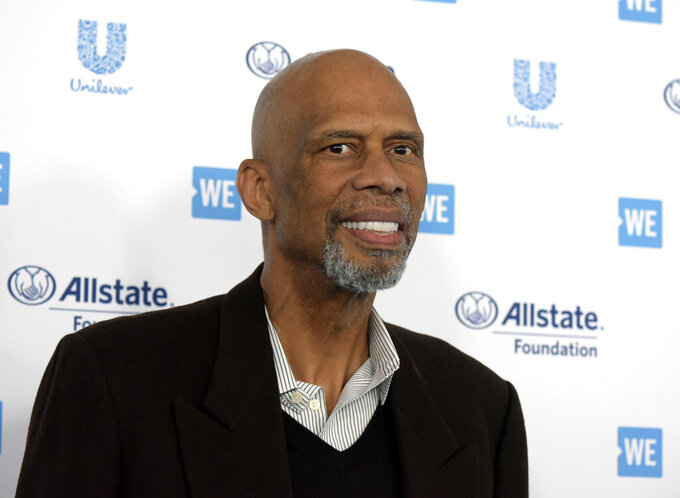 FILE - Kareem Abdul-Jabbar arrives at WE Day California at The Forum on Thursday, April 25, 2019, in Inglewood, Calif. Kareem Abdul-Jabbar has revealed that he received the COVID-19 vaccine and is encouraging others to consider doing the same. The Basketball Hall of Famer and NBA's leading all-time scorer has taped a short message that will be aired beginning Monday during broadcasts of games played on the Martin Luther King Jr. Day holiday. (Photo by Richard Shotwell/Invision/AP)