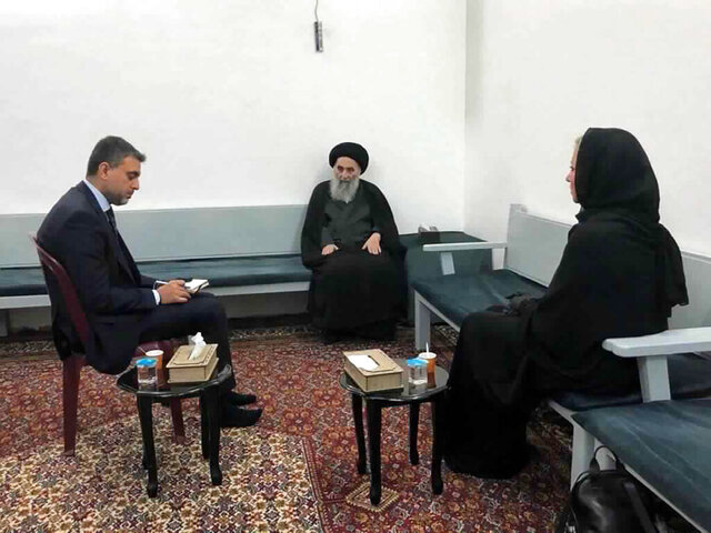 This handout photo from the office of Grand Ayatollah Ali al-Sistani shows Iraq's top Shiite cleric Grand Ayatollah Ali al-Sistani, center, meeting with U.N. envoy to Iraq Jeanine Hennis-Plasschaert, right, in Najaf, Iraq, Sunday, Sept. 13, 2020. In a statement released by his office after meeting the U.N. envoy Al-Sistani threw his support behind the prime minister's announcement to hold parliamentary elections ahead of schedule next year, a key demand of protesters. (Office of Grand Ayatollah Ali al-Sistani, via AP)