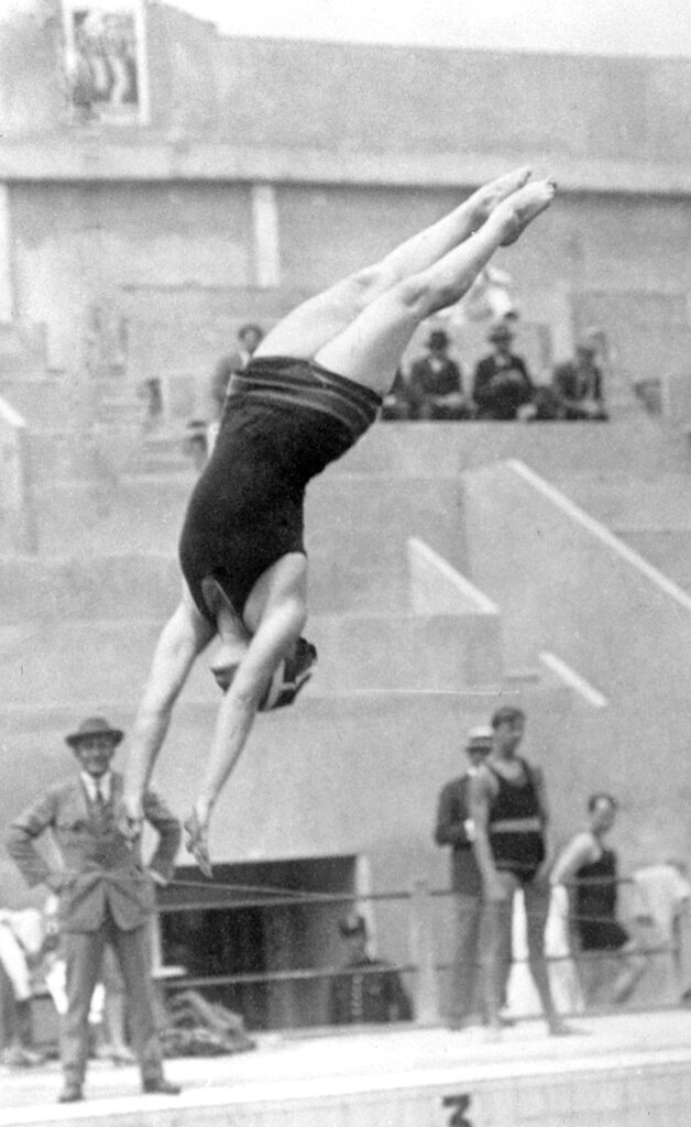 FILE - In this 1924 file photo, American diver Elizabeth Becker competes during the women's springboard competition at the 1924 Olympics in Paris. She went on to win the gold medal. (AP Photo/File)