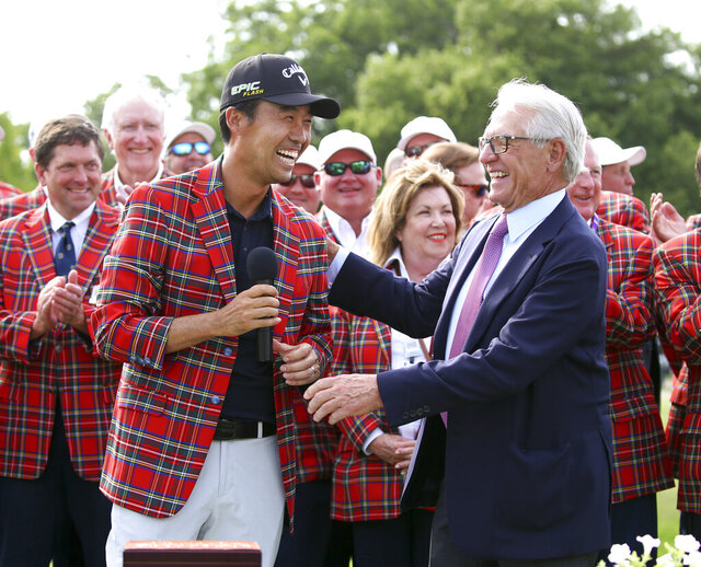 FILE - In this May 26, 2019, file photo, Kevin Na, front left, is congratulated by Charles Schwab after winning the Charles Schwab Challenge golf tournament in Fort Worth, Texas. The Colonial on May 21-24, 2020, is the next event on the PGA Tour schedule. The tournament is trying to prepare without knowing if the new coronavirus will lead to it being canceled. (AP Photo/Richard W. Rodriguez, File)