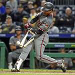 Arizona Diamondbacks' Jarrod Dyson breaks his bat on a fielder's choice in the seventh inning of a baseball game against the Pittsburgh Pirates in Pittsburgh, Monday, April 22, 2019. Diamondbacks' Nick Ahmed was out attempting to score from third on the play. (AP Photo/Gene J. Puskar)