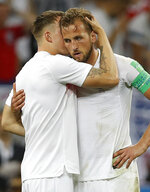 England's Phil Jones hugs with England's Harry Kane, right, during the semifinal match between Croatia and England at the 2018 soccer World Cup in the Luzhniki Stadium in Moscow, Russia, Wednesday, July 11, 2018. (AP Photo/Francisco Seco)