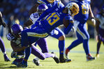 Los Angeles Chargers wide receiver Keenan Allen is brought down by Minnesota Vikings cornerback Trae Waynes, left, during the first half of an NFL football game Sunday, Dec. 15, 2019, in Carson, Calif. (AP Photo/Kelvin Kuo)