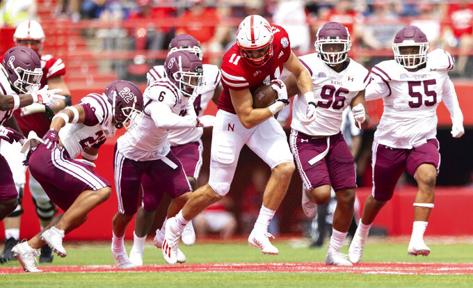 Nebraska's Austin Allen (11) carries the ball ahead of Fordham defenders, from left, Deon Montgomery (22), Jesse Bramble (6), Elisha Armstrong (96) and Gavin Watson (55) during the second half of an NCAA college football game Saturday, Sept. 4, 2021, at Memorial Stadium in Lincoln, Neb. (AP Photo/Rebecca S. Gratz)