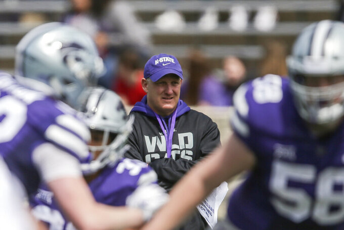 FILE - In this April 13, 2019, file photo, Kansas State head coach Chris Klieman watches his team during an NCAA college football practice in Manhattan, Kan. Klieman knew he had a problem when he looked at the roster he was inheriting at Kansas State. He had a veteran QB. Veteran offensive line. Lots of veterans on defense. And not a single running back. None. At all.(Travis Heying/The Wichita Eagle via AP, File)