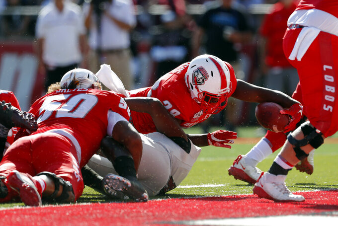 New Mexico running back Ahmari Davis (28) dives into the end zone to score a touchdown during the first half of an NCAA college football game against New Mexico State on Saturday, Sept. 21, 2019 in Albuquerque, N.M. (AP Photo/Andres Leighton)