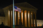 The American flag blows in the wind after it was lowered to half-staff Friday, Sept. 18, 2020, in Washington, after the Supreme Court announced that Supreme Court Justice Ruth Bader Ginsburg has died of metastatic pancreatic cancer at age 87. (AP Photo/Alex Brandon)