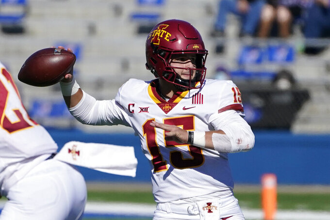 Iowa State quarterback Brock Purdy passes to a teammate during the second half of an NCAA college football game against Kansas in Lawrence, Kan., Saturday, Oct. 31, 2020. Iowa State defeated Kansas 52-22. (AP Photo/Orlin Wagner)