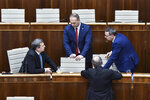 """From left, Parliamentary Chair Andrej Danko (SNS), MP Radovan Balaz (SNS), MP Tibor Bernatak (SNS) during a Parliamentary session in Bratislava, Slovakia, Friday, Nov. 29, 2019. Lawmakers in Slovakia are scheduled to debate a proposed law that would compel women seeking an abortion to first have an ultrasound and listen to the heartbeat of the embryo or fetus, a move many groups have decried as a backward step for women's rights. The bill was submitted by three members of the conservative Slovak National Party (SNS) who wrote that it is intended """"to ensure that women are informed about the current stage of their pregnancy"""" before having an abortion. (Pavol Zachar/TASR via AP)"""