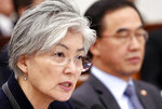 South Korean Foreign Minister Kang Kyung-wha answers a lawmaker's question as Unification Minister Cho Myoung-gyon, right, sits at the National Assembly in Seoul, South Korea, Thursday, Nov. 8, 2018. Kang quoted U.S. officials as saying that it was North Korea that canceled a meeting this week between U.S. Secretary of State Mike Pompeo and a senior North Korean official on nuclear issues. (Kim Ju-hyung/Yonhap via AP)