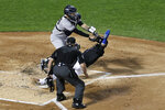 New York Mets' Jonathan Villar, right, scores a run under a tag by New York Yankees catcher Gary Sanchez, top, in front of home plate umpire Ted Barrett, bottom, during the first inning of a baseball game on Friday, Sept. 10, 2021, in New York. (AP Photo/Adam Hunger)