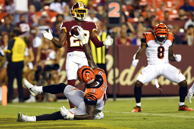 Cincinnati Bengals wide receiver Auden Tate (19) celebrates a touchdown during the third quarter of the team's NFL preseason football game against the Washington Redskins in Landover, Md., Thursday, Aug. 15, 2019. Bengals wide receiver Stanley Morgan (8) also celebrates, while Redskins defensive back D.J. White (29) watches. The Bengals won 23-13. (AP Photo/Susan Walsh)