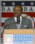 FILE - In this July 28, 2013, file photo, Baseball Hall of Famer Joe Morgan speaks during ceremonies in Cooperstown, N.Y. Joe Morgan has died. A family spokesman says he died at his home Sunday, Oct. 11, 2020, in Danville, Calif. (AP Photo/Mike Groll, File)