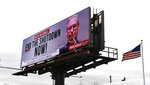 An electronic billboard, sponsored by the Democratic Coalition,  shown Saturday, Jan. 12, 2019 in Nicholasville, Ky.  McConnell, who is up for re-election in 2020 in a state where Trump tends to be more popular than he is, sees no other choice than to stand back and let the president who took the country into the shutdown decide how he wants to get out of it. (AP Photo/Timothy D. Easley)