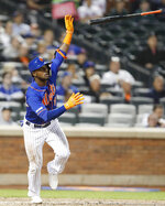 New York Mets' Adeiny Hechavarria (11) flips his bat after hitting a three-run home run during the fourth inning of a baseball game against the Detroit Tigers, Friday, May 24, 2019, in New York. (AP Photo/Kathy Willens)