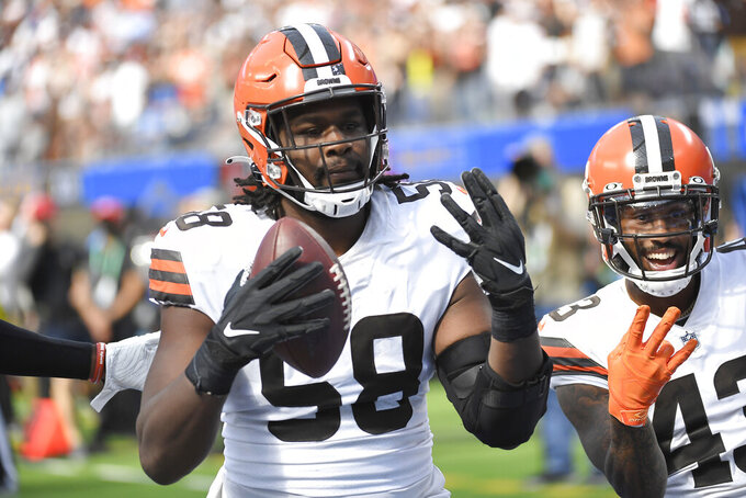 Cleveland Browns defensive tackle Malik McDowell (58) recovers a fumble on a kickoff return during the first half of an NFL football game against the Los Angeles Chargers Sunday, Oct. 10, 2021, in Inglewood, Calif. (AP Photo/Kevork Djansezian)