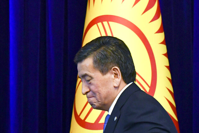 FILE In this file photo taken on Friday, June 14, 2019, Kyrgyzstan's President Sooronbai Jeenbekov leaves a news conference in Bishkek, Kyrgyzstan. The president of Kyrgyzstan announced his resignation in a bid to end the turmoil that has engulfed the Central Asian nation after a disputed parliamentary election. In a statement Thursday, Oct. 15, 2020 released by his office. (AP Photo/Vladimir Voronin, File)