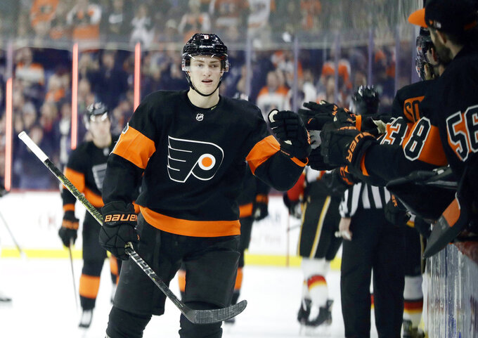 Philadelphia Flyers' Travis Sanheim (6) celebrates with teammates after scoring a goal during the first period of an NHL hockey game against the Calgary Flames , Saturday, Jan. 5, 2019, in Philadelphia. (AP Photo/Matt Slocum)