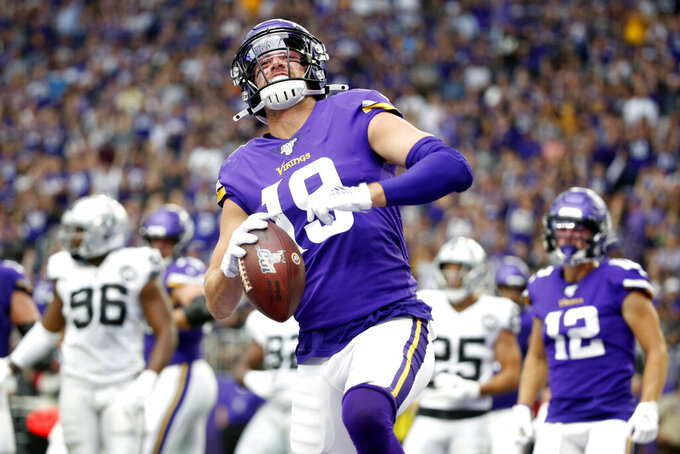 Minnesota Vikings wide receiver Adam Thielen celebrates after scoring on a 1-yard touchdown run during the first half of an NFL football game against the Oakland Raiders, Sunday, Sept. 22, 2019, in Minneapolis. (AP Photo/Bruce Kluckhohn)