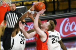 Central Florida forward C.J. Walker (21) blocks a shot-attempt by Auburn guard Justin Powell, center, as Central Florida guard Dre Fuller Jr., right, comes in to help during the second half of an NCAA college basketball game, Monday, Nov. 30, 2020, in Orlando, Fla. (AP Photo/John Raoux)