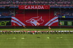 Search and Rescue members descend onto the field prior to the start of a baseball game between the Toronto Blue Jays and the Kansas City Royals on Canada Day in Toronto, Monday, July 1, 2019. (Jon Blacker/The Canadian Press via AP)