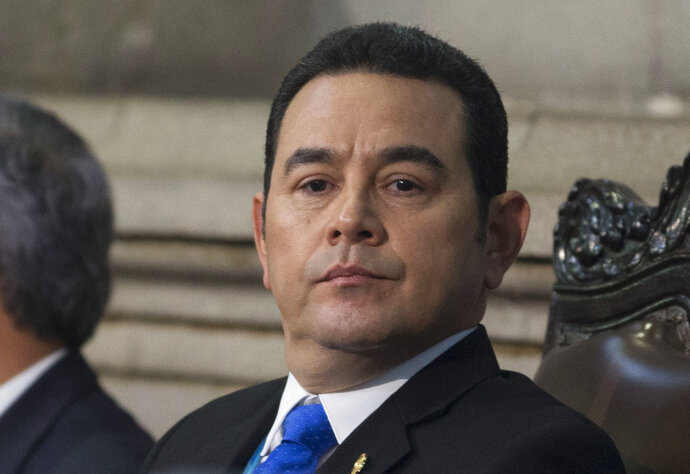 FILE - This Jan. 14, 2018 file photo shows Guatemala's President Jimmy Morales at his second annual State of the Nation, in Guatemala City. The office of Attorney General and the United Nations International Commission Against Impunity are asking the Guatemalan Supreme Court to withdraw Morales' immunity from prosecution to investigate him on allegations of illicit election campaign financing by his party. (AP Photo/Moises Castillo, File)