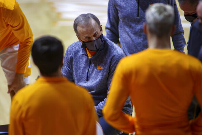 Tennessee head coach Rick Barnes talks to his team during a timeout during an NCAA college basketball game against Tennessee Tech, Friday, Dec. 18, 2020, in Knoxville, Tenn. (Randy Sartin/USA TODAY Sports via AP, Pool)