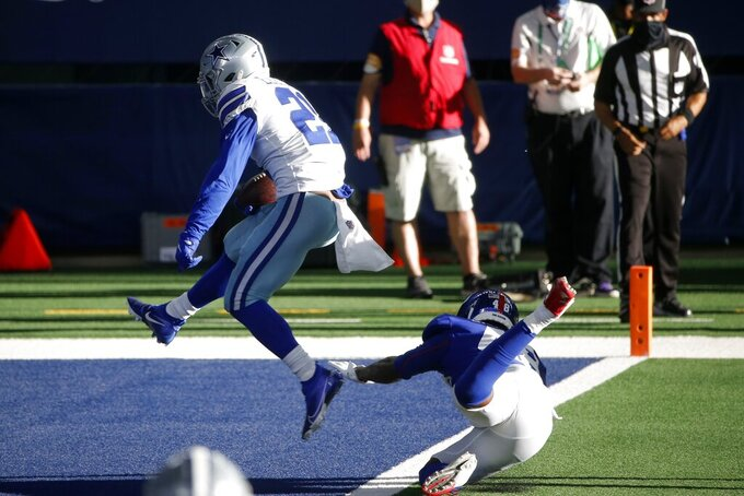 New York Giants linebacker Tae Crowder (48) is unable to stop Dallas Cowboys running back Ezekiel Elliott (21) from reaching the end zone for a touchdown in the second half of an NFL football game in Arlington, Texas, Sunday, Oct. 11, 2020. (AP Photo/Ron Jenkins)