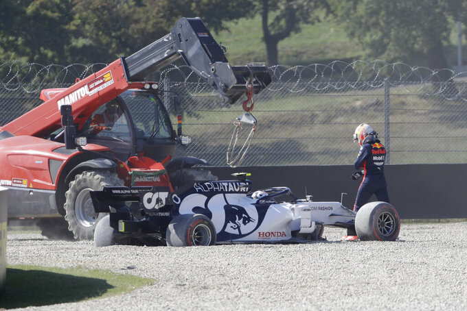Red Bull driver Max Verstappen of the Netherlands walks next AlphaTauri driver Pierre Gasly of France, during the Formula One Grand Prix of Tuscany, at the Mugello circuit in Scarperia, Italy, Sunday, Sept. 13, 2020. (AP Photo/Luca Bruno, Pool)