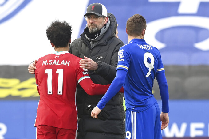 Liverpool's manager Jurgen Klopp, center, comforts Liverpool's Mohamed Salah end of the English Premier League soccer match between Leicester City and Liverpool at the King Power Stadium in Leicester, England, Saturday, Feb. 13, 2021. (Michael Regan/Pool Photo via AP)