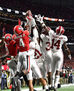 Georgia receivers attempt the last catch against Alabama during the second half of the Southeastern Conference championship NCAA college football game, Saturday, Dec. 1, 2018, in Atlanta. Alabama won 35-28. (AP Photo/John Amis)