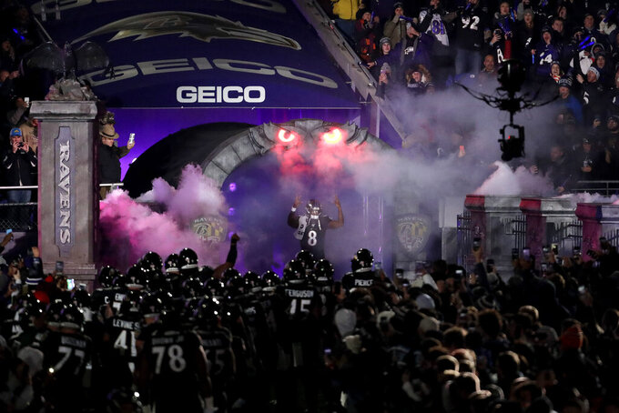 Baltimore Ravens quarterback Lamar Jackson (8) is introduced onto the field prior to an NFL football game against the New York Jets, Thursday, Dec. 12, 2019, in Baltimore. (AP Photo/Julio Cortez)