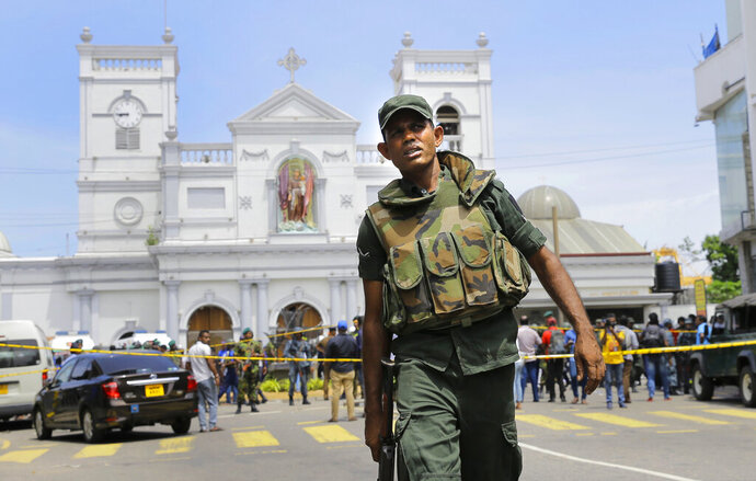 FILE - In this April 21, 2019 file photo, Sri Lankan Army soldiers secure the area around St. Anthony's Shrine after a blast in Colombo, Sri Lanka. Sri Lanka's attorney general on Thursday, June 20 directed the acting police chief to initiate a criminal investigation against nine senior police officers for their