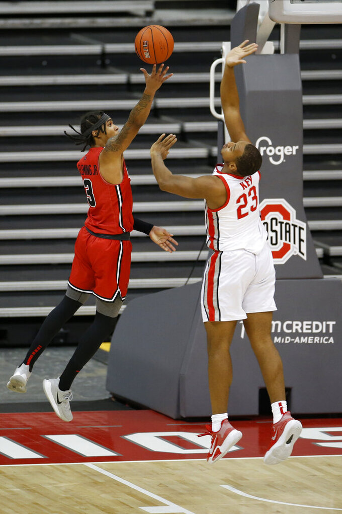 Illinois State's Howard Fleming, left, shoots over Ohio State's Zed Key during the first half of an NCAA college basketball game Wednesday, Nov. 25, 2020, in Columbus, Ohio. (AP Photo/Jay LaPrete)
