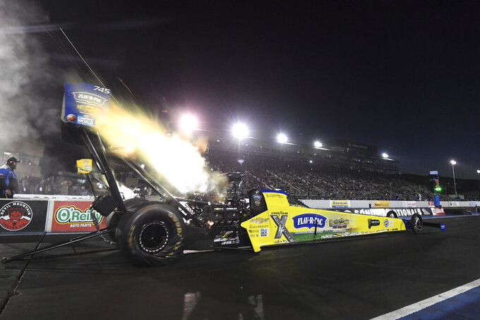 In this photo provided by the NHRA, Brittany Force takes part in Top Fuel qualifying Friday, July 23, 2021, at the NHRA Sonoma Nationals drag races in Sonoma, Calif. (Marc Gewertz/NHRA via AP)