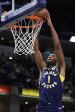 Indiana Pacers forward T.J. Warren (1) dunks during the second half of the team's NBA basketball game against the Washington Wizards, Wednesday, Nov. 6, 2019, in Indianapolis. Indiana won 121-106. (AP Photo/Darron Cummings)