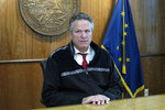 Alaska Gov. Mike Dunleavy looks up at a reporter during a press briefing on Tuesday, Sept. 14, 2021, in Juneau, Alaska. Tuesday marked the last day of the third special session of the year. (AP Photo/Becky Bohrer)