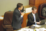 New Mexico Sen. Joseph Cervantes, D-Las Cruces, left, advocates for approval of a red-flag gun law at the state Capitol in Santa Fe, N.M., on Friday, Feb. 7, 2020. The proposal would allow law enforcement officers to petition a state district court to order the temporary surrender of firearms by people who appear to pose a danger to themselves or others. (AP Photo/Morgan Lee)