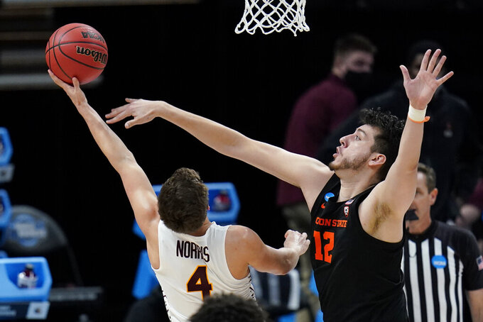 Oregon State center Roman Silva (12) tries to block a shot by Loyola Chicago guard Braden Norris (4) during the second half of a Sweet 16 game in the NCAA men's college basketball tournament at Bankers Life Fieldhouse, Saturday, March 27, 2021, in Indianapolis. (AP Photo/Jeff Roberson)