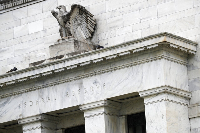 "FILE - This May 22, 2020, file photo shows the Federal Reserve building in Washington. A Federal Reserve survey of business conditions around the country has found that the U.S. economy grew at a ""slight to modest"" pace in September 2020 and early October. (AP Photo/Patrick Semansky, File)"