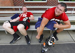 Atlanta Falcons first round picks offensive lineman Chris Lindstrom, right, and offensive tackle Kaleb McGary relax on a bench after the first day of NFL football rookie camp, Friday, May 10, 2019, in Flowery Branch, Ga. (Curtis Compton/Atlanta Journal-Constitution via AP)