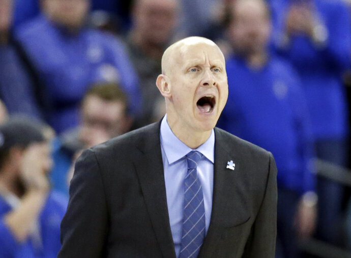 Xavier coach Chris Mack yells instructions during the second half of an NCAA college basketball game against Creighton in Omaha, Neb., Saturday, Feb. 10, 2018. Xavier won 72-71. (AP Photo/Nati Harnik)