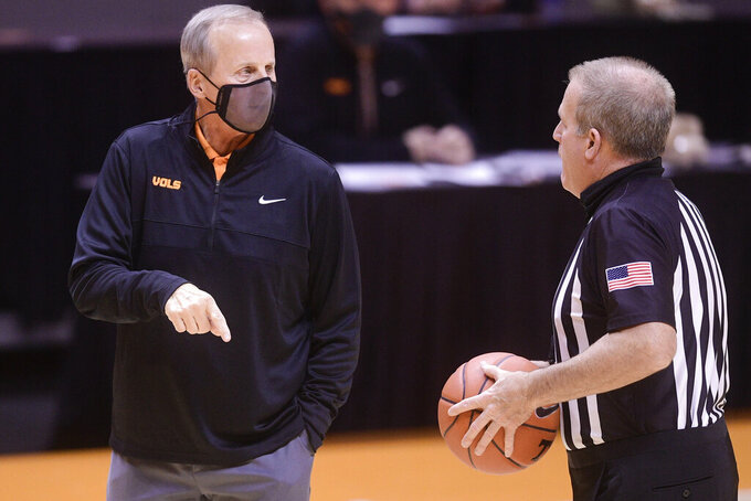 Tennessee coach Rick Barnes speaks to a referee during the team's NCAA college basketball game against Colorado on Tuesday, Dec. 8, 2020, in Knoxville, Tenn. (Caitie McMekin/Knoxville New-Sentinel via AP, Pool)
