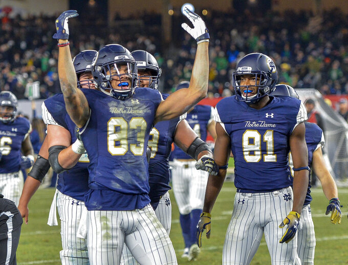 Notre Dame wide receiver Chase Claypool (83) celebrates a touchdown during an NCAA college football game against Syracuse, Saturday, Nov. 17, 2018, at Yankee Stadium in New York. (AP Photo/Howard Simmons)