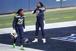 FILE - Twin brothers Seattle Seahawks cornerback Shaquill Griffin (26) and linebacker Shaquem Griffin (49) on the field before an NFL football game against the Los Angeles Rams, Sunday, Dec. 27, 2020, in Seattle. The Griffin twins are already talking trash three months before they're on opposite sidelines for the first time in their lives. Shaquill and Shaquem Griffin were teammates at every level of football growing up in St. Petersburg. They also played together at UCF and with the Seattle Seahawks the last three years. The seemingly inseparable brothers hit free agency in March and hoped to be reunited again. But it didn't work out. (AP Photo/Elaine Thompson, File)