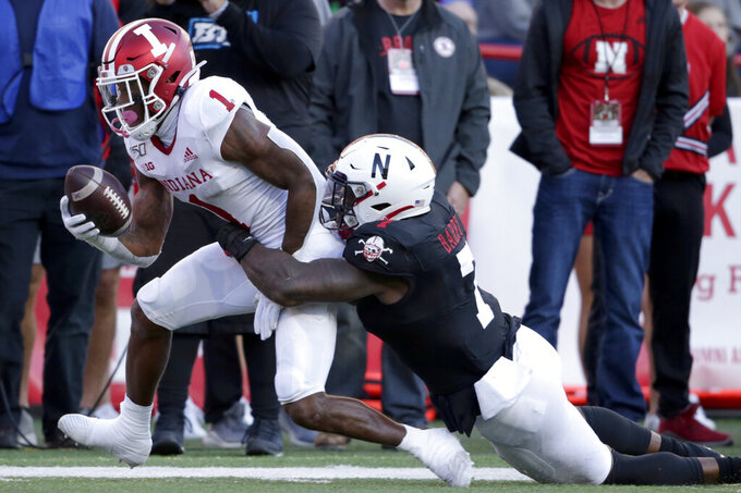 Indiana wide receiver Whop Philyor (1) is tackled by Nebraska linebacker Mohamed Barry (7) during the second half of an NCAA college football game in Lincoln, Neb., Saturday, Oct. 26, 2019. Indiana won 38-31. (AP Photo/Nati Harnik)