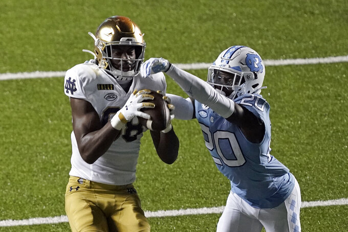 Notre Dame wide receiver Javon McKinley (88) catches a pass while North Carolina defensive back Tony Grimes (20) defends during the second half of an NCAA college football game in Chapel Hill, N.C., Friday, Nov. 27, 2020. (AP Photo/Gerry Broome)
