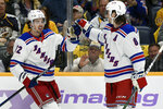 New York Rangers center Filip Chytil (72), of the Czech Republic, is congratulated by  defenseman Jacob Trouba (8) after scoring against the Nashville Predators in the first period of an NHL hockey game Saturday, Nov. 2, 2019, in Nashville, Tenn. (AP Photo/Mark Zaleski)